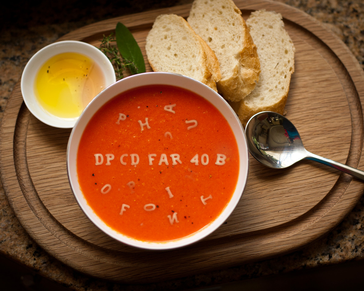 Photo of bowl of alphabet tomato soup